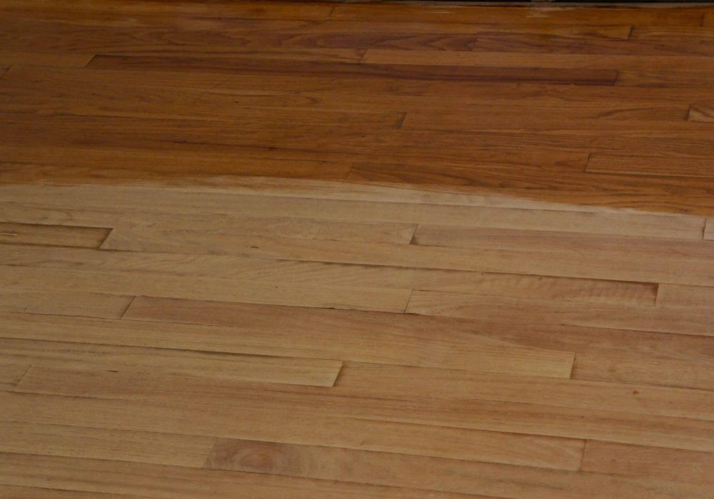 Sanded Hardwood Floor with Polyurethane on Half of it.